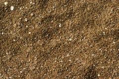 Plan rapproché d'à sable jaune sur la plage Images stock