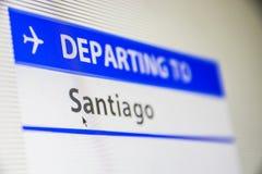 Plan rapproché d'écran d'ordinateur de vol vers Santiago Images stock