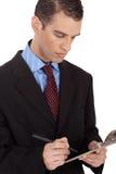 Plan rapproché d'un homme d'affaires avec le bloc-notes Photos stock