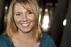 Plan rapproché d'un sourire de femme Photographie stock libre de droits