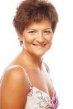 Plan rapproché d'un sourire mûr de femme Images stock