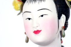 Plan rapproché d'une belle figurine chinoise. Photo stock
