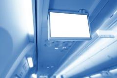 Plan rapproché d'une main du ` s de passager d'avion appuyant sur un bouton appeler une hôtesse Photographie stock