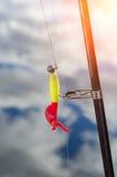 Plan rapproché de babioles de pêche sur la tige Photos libres de droits