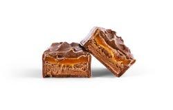 Plan rapproché de bar de chocolat d'isolement sur le blanc Image stock