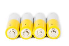 Plan rapproché de batteries d'aa sur le fond blanc Images stock