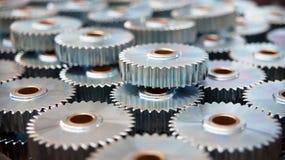 Plan rapproché de beaucoup de vitesses en métal Images stock