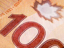 Plan rapproché de billet d'un dollar du Canadien 100 Images stock