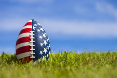Plan rapproché de boule de rugby avec la bannière étoilée Photographie stock