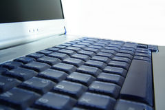 Plan rapproché de cahier/d'ordinateur portatif Images stock