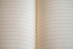 Plan rapproché de carnet dissous - la vraie feuille de carnet raye Le Su photo stock