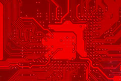 Plan rapproché de circuit électronique rouge de carte mère avec le processeur Photo stock
