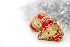 Plan rapproché de coeur rouge de boules de Noël Photographie stock libre de droits