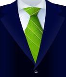 Plan rapproché de costume avec le lien vert Photographie stock