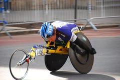 Plan rapproché de coureur de fauteuil roulant de marathon de 2014 NYC Photographie stock libre de droits