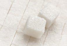 Plan rapproché de cube en sucre de raffinage images stock