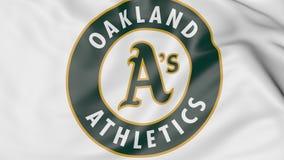 Plan rapproché de drapeau de ondulation avec le logo d'équipe de baseball des Oakland Athletics MLB, rendu 3D Photo libre de droits