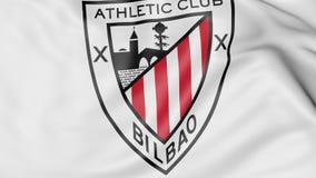 Plan rapproché de drapeau de ondulation avec le logo de club du football de l'Athletic Bilbao, rendu 3D Photos stock