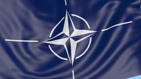 Plan rapproché de drapeau de ondulation avec le logo de l'OTAN d'Organisation du Traité de l'Atlantique Nord, boucle sans couture clips vidéos