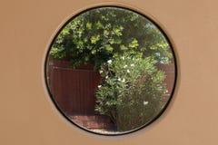 Plan rapproché de fenêtre ronde Photographie stock libre de droits