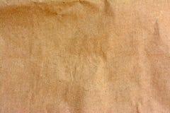 Plan rapproché de fond brun de texture de sac de papier Photos stock