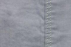 Plan rapproché de fond gris de texture de /denim de tissu de denim images libres de droits