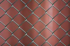 Plan rapproché de fond rouge foncé peint d'isolement de fer en métal de fil de chaîne de maillon d'éon noir géométrique simple de image libre de droits