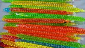 Plan rapproché de gelée en plastique colorée dans les tubes photographie stock libre de droits