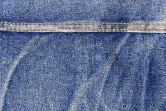 Plan rapproché de jeans avec la couture Photos stock
