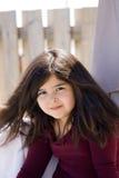 Plan rapproché de jeune fille avec le long cheveu brun Photographie stock libre de droits