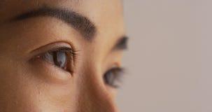 Plan rapproché de l'oeil de la femme japonaise célibataire photo stock