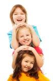 Verticale de trois enfants Image libre de droits