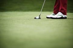 Plan rapproché de la mise de golfeur Photographie stock
