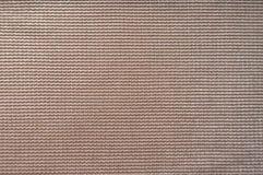 Plan rapproché de la surface du tissu crème rosâtre Photographie stock