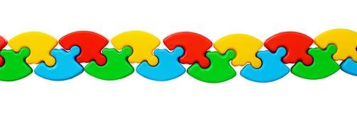 Plan rapproché de ligne colorée de puzzles Images stock