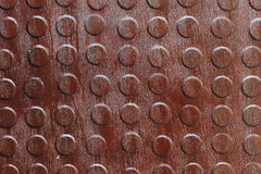 Plan rapproché de métal rouillé avec des molettes Photos stock