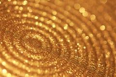 Plan rapproché de plat avec le bokeh d'or et les lumières de scintillement Images stock