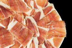 Plan rapproché de plat de jambon de gland avec le fond noir, vue supérieure Photo libre de droits