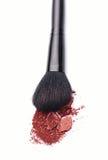 Plan rapproché de poudre de maquillage avec la brosse Photographie stock libre de droits