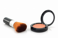 Plan rapproché de poudre de visage et de brosse de maquillage Photographie stock
