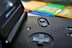 Plan rapproché de PS de Gameboy avec des jeux photographie stock libre de droits