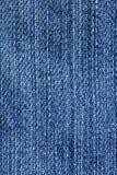 Plan rapproché de tissu de jeans - texture bleue d'armure de denim Photos libres de droits