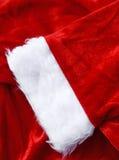 Plan rapproché de tissu de Santa de Noël, pour le fond Images libres de droits