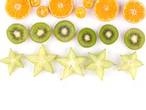 Plan rapproché de tranches exotiques mûres de fruits d'isolement sur un fond blanc Photographie stock