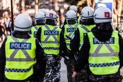 Plan rapproché de vitesse et de protections de police Photos libres de droits