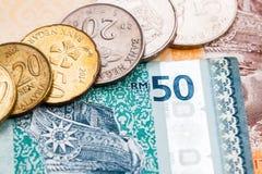 Plan rapproché des billets et de la monnaie de devise de ringgit de la Malaisie Images libres de droits