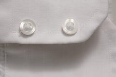 Plan rapproché des boutons sur le tissu Photo stock