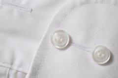 Plan rapproché des boutons sur le tissu Photos stock