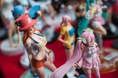 Plan rapproché des chiffres sexy de manga à la convention cosplay de connaisseur photographie stock