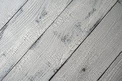 Plan rapproché des planches en bois âgées par blanc diagonal image stock